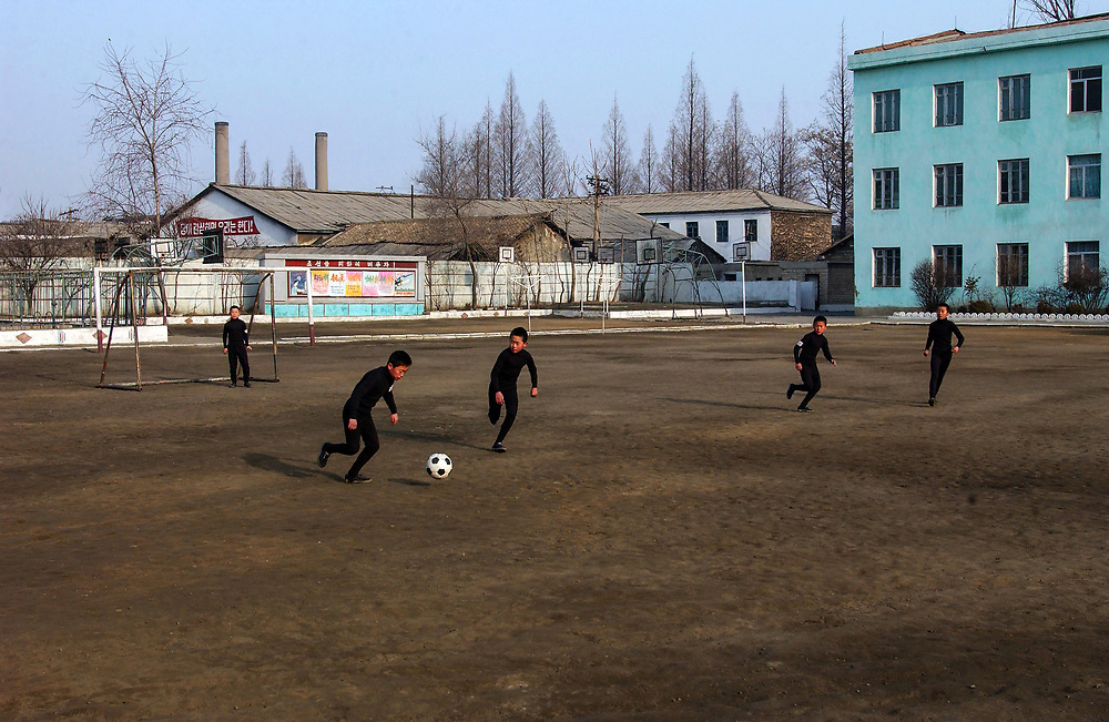 Boys playing football<br /> Kangan Primary school in Sonkyo District, Pyongyang<br /> <br /> copyright: Jeremy Horner 2004<br /> &copy;Jeremy Horner<br /> 15 Mar 2004
