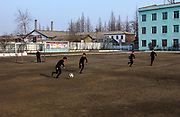 Boys playing football<br /> Kangan Primary school in Sonkyo District, Pyongyang<br /> <br /> copyright: Jeremy Horner 2004<br /> ©Jeremy Horner<br /> 15 Mar 2004