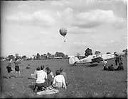 20/05/1956<br /> 05/20/1956<br /> 20 May 1956<br /> Aero Club of Ireland Annual Air Show at Weston airfield, Leixlip, Co. Kildare. Spectators watch the accent of a  Phoenix Ale hot-air balloon. Note the  Miles Messenger (EI-AGU) aircraft on right.