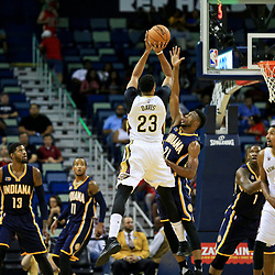 Oct 4, 2016; New Orleans, LA, USA;  New Orleans Pelicans forward Anthony Davis (23) shoots over Indiana Pacers forward Thaddeus Young (21) during the first quarter of a game at the Smoothie King Center. Mandatory Credit: Derick E. Hingle-USA TODAY Sports