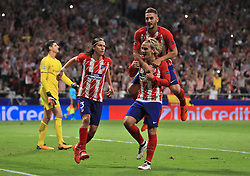 Atletico Madrid's Antoine Griezmann (second right) celebrates after scoring his side's first goal