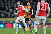 Olivier Giroud (Arsenal) and Curtis Davies (Hull City) during the The FA Cup fifth round match between Hull City and Arsenal at the KC Stadium, Kingston upon Hull, England on 8 March 2016. Photo by Mark P Doherty.