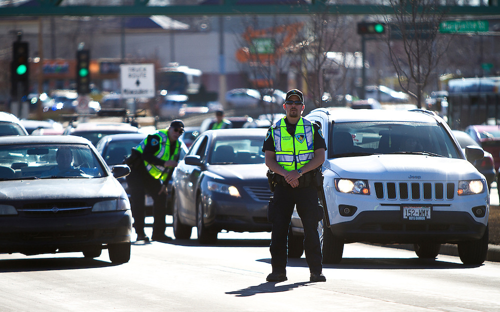 Madison Police block traffic along Washington Avenue outside the Wisconsin Department of Corrections as protests moved to the streets, March 11, 2015. Protestors rallied for the fifth day in a row, after the shooting death of Tony Robinson, Jr. by Madison Police inside his home on March 6, 2015. REUTERS/Ben Brewer (UNITED STATES)