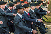The Combined Cavalry OCA Parade, Hyde Park. More than two thousand cavalrymen march in a mixture of uniforms or suits with bowler hats (for officers only) and furled umbrellas creating a quintessentially British scene. It is the 93rd Annual Parade and Service of The Combined Cavalry Old Comrades Association at the Cavalry Memorial adjacent and the Bandstand in Hyde Park. Field Marshal Baron Guthrie GCB, LVO, OBE, DL Colonel The Life Guards and Gold Stick took the salute at the march past for both serving and former soldiers of all the Regiments of Regular Cavalry and many Yeomanry Regiments.