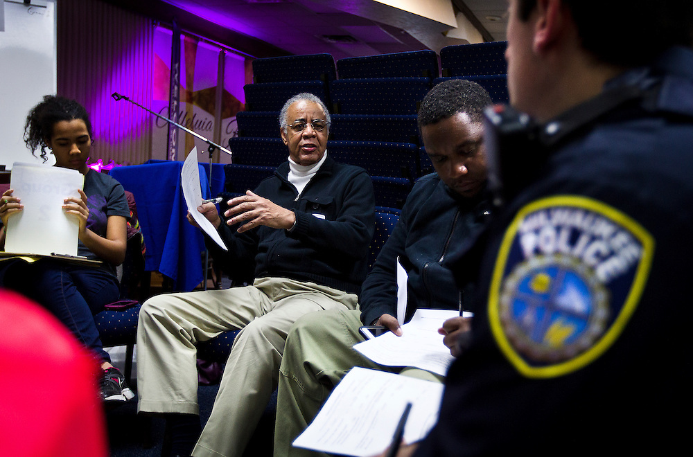 MILWAUKEE, WI – MARCH 28: Churchill Caruthers, Jr., left, poses a question of Milwaukee Police Department officer Ismar Kulenovic during a Zeidler Center Police and Resident discussion circle at Grace Fellowship Church on Monday, March 28, 2016.