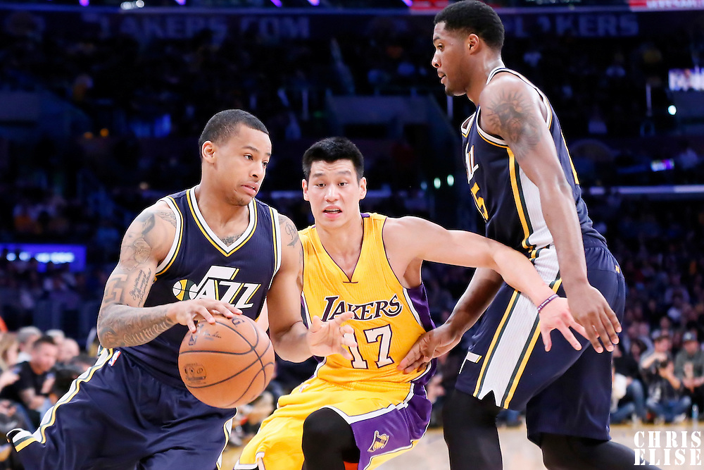 19 March 2015: Utah Jazz guard Trey Burke (3) drives past Los Angeles Lakers guard Jeremy Lin (17) on a screen set by Utah Jazz forward Derrick Favors (15) during the Utah Jazz 80-73 victory over the Los Angeles Lakers, at the Staples Center, Los Angeles, California, USA.