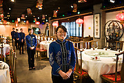 Waitresses in Chinese restaurant, Beijing, China