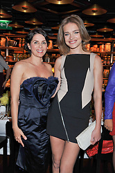 Left to right, SADIE FROST and NATALIA VODIANOVA at a dinner to celebrate the beginning of a unique partnership between The Naked Heart Foundation and W's Newest Hotel W St.Petersburg -The 'For Russia With Love' dinner was hosted by Sadie Frost and Natalia Vodianova at Spice Market restaurant, W London, Leicester Square, London on 2nd June 2011.
