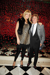 ROD STEWART and his wife PENNY LANCASTER at a party to celebrate the 10th Anniversary of Claridge's Bar, Claridge's Hotel, Brook Street, London on 11th November 2008.