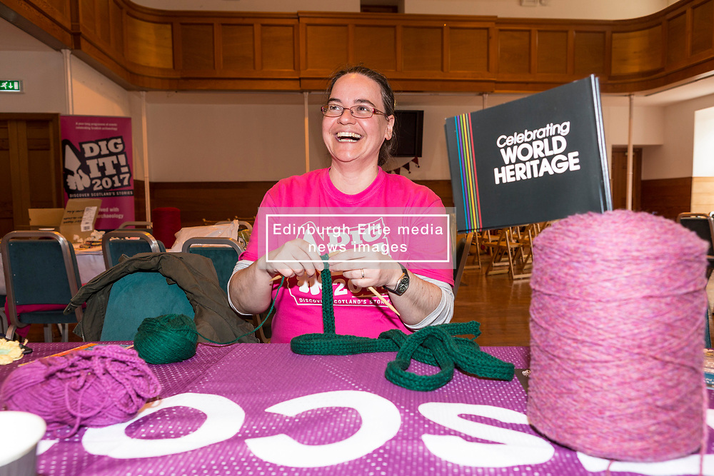 Yarn Bombing during the Scotland-wide World Heritage Day festivities. Six unique events, coordinated by Dig It! 2017, celebrated Scotland's six World Heritage Sites as part of the 2017 Year of History, Heritage and Archaeology. <br /> <br /> Pictured: Oner of the volunteers, Heather Doherty making vines for the yarn-bomb