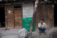 A man talks on his cell phone on a Kargil street