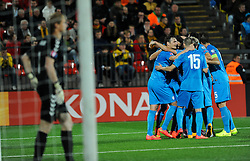 Players of Slovenia celebrate after Milivoje Novakovic of Slovenia scored first goal during football match between National teams of Lithuania and Slovenia at Round 3 of Euro 2016 Qualifications, on October 12, 2014 in Vilnius, Lithuania.  Photo by Robertas Dackus / Sportida.com