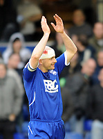 St Andrews Birmingham City v Southampton (1-0) Championship 07/03/2009<br /> Captain Courageous. Lee Carsley (Birmingham)  salutes fans after he played on with a gash in his head  covered with a bandage after  collision with teammate Radhi Jaidi <br /> Photo Roger Parker Fotosports International