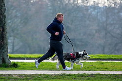 © Licensed to London News Pictures. 24/03/2020. Leeds UK. A man walks his dog at Temple Newsam park this morning on the first day of the Covid 19 Lockdown. Photo credit: Andrew McCaren/LNP