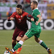 Cristiano Ronaldo, Portugal, is challenged by David Meyler, Ireland, during the Portugal V Ireland International Friendly match in preparation for the 2014 FIFA World Cup in Brazil. MetLife Stadium, Rutherford, New Jersey, USA. 10th June 2014. Photo Tim Clayton