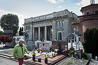 VERBANIA, ITALY - 18 APRIL 2017: A man walks by the Morano family tomb, where Emma Morano was buried, in Verbania, Italy, on April 18th 2017.<br /> <br /> Emma Morano, born in 1899, was an Italian supercentenarian who, prior to her death at the age of 117 years and 137 days, was the world's oldest living person whose age had been verified, and the last living person to have been verified as being born in the 1800s. She died on April 15th 2017.