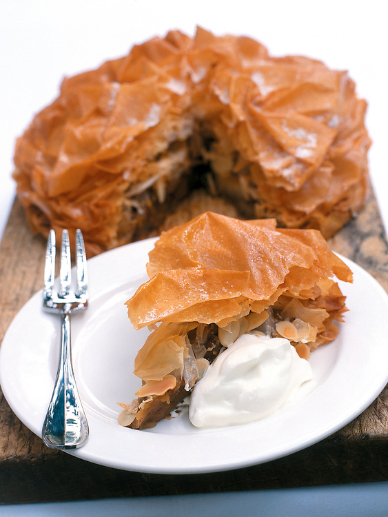 slice of plated apple pie with cream