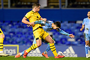 Milton Keynes Dons midfielder Jordan Houghton (24) fouls Coventry City midfielder Liam Walsh (20) during the EFL Sky Bet League 1 match between Coventry City and Milton Keynes Dons at the Trillion Trophy Stadium, Birmingham, England on 11 January 2020.