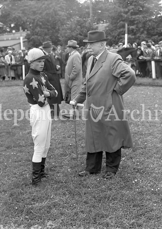R1605<br /> Apprentice Jockey  M. Murray pictured with trainer Ashe, location unknown, June 5 1958.<br /> (Part of the Independent Newspapers Ireland/NLI collection.)