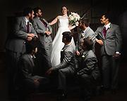 Elegant wedding portrait of bride and adoring groomsmen in Houston, Texas, Gerard Harrison wedding photographer Image Theory Photoworks.