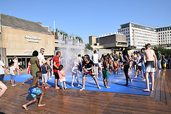 Children enjoying the water fountains outside Southbank Centre on a very hot Bank Holiday Monday, August 2019 UK