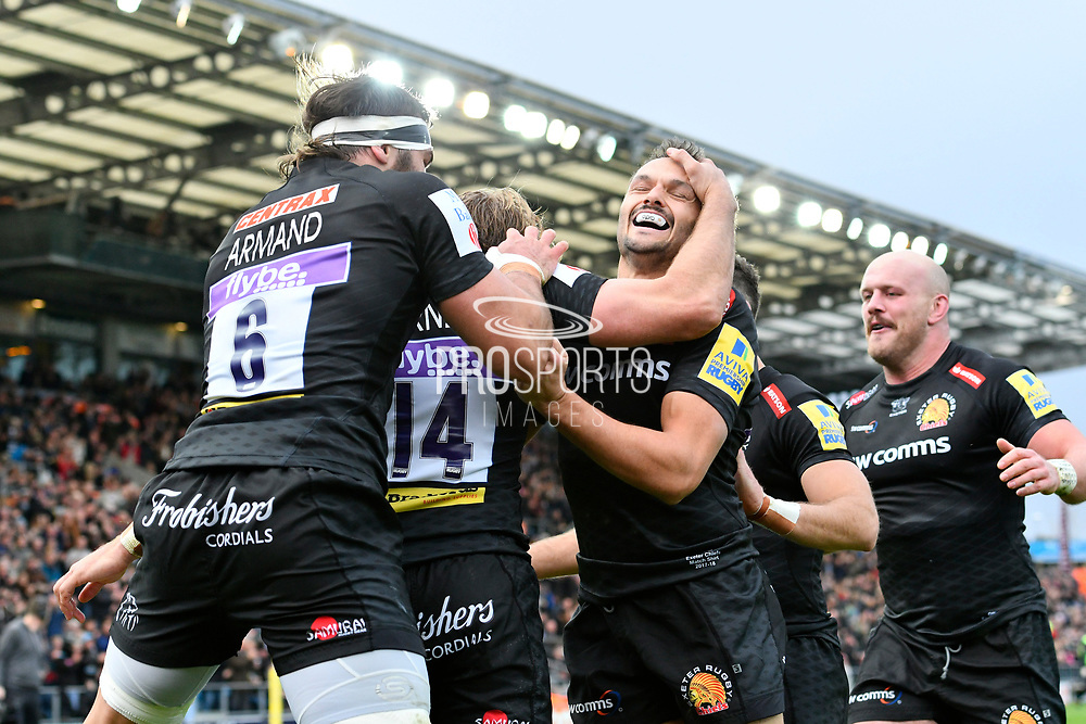 Lachie Turner of Exeter Chiefs is mobbed after scoring a try to give a 5-0 lead during the Aviva Premiership match between Exeter Chiefs and Harlequins at Sandy Park, Exeter, United Kingdom on 19 November 2017. Photo by Graham Hunt.