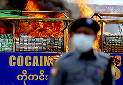 June 26, 2017 - Seized drugs are burnt in Yangon, Myanmar. Myanmar authorities ceremonially burned 25 kinds of seized narcotic drugs in Yangon on Monday to mark the International Day against Drug Abuse and Illicit Trafficking. (Credit Image: © U Aung/Xinhua via ZUMA Wire)