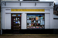 LEWIS AND HARRIS, SCOTLAND - CIRCA APRIL 2016: Typical storefront in Stornoway one of the major towns of outer islands of Lewis and Harris in Scotland..