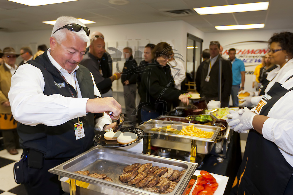 RICHMOND, VA - APR 28, 2012:  Jack Roush and the Roush Fenway drivers prepare hamburgers for the media sponsored by Cargill before the Capital City 400 Presented by Virginia Is For Lovers at the Richmond International Raceway in Richmond, VA.