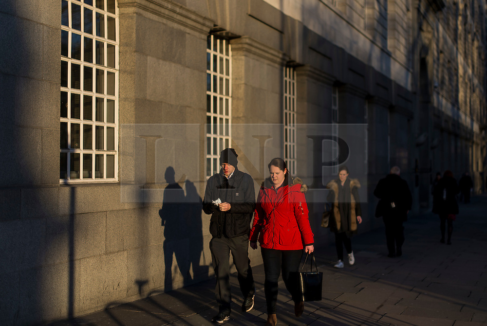 © Licensed to London News Pictures. 28/01/2016. London, UK. Commuter in warm sunshine in Westminster on a clear day at sunrise in London on a cold winter morning. Photo credit: Ben Cawthra/LNP
