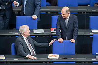 21 MAR 2019, BERLIN/GERMANY:<br /> Horst Seehofer (L), CSU, Bundesinnenminister, und Olaf Scholz (R), SPD, Bundesfinanzminister, im Gespraech, vor Beginn der Bundestagsdebatte zur Regierungserklaerung der Bundeskanzlerin zum Europaeischen Rat, Plenum, Deutscher Bundestag<br /> IMAGE: 20190321-01-008<br /> KEYWORDS: Gespräch
