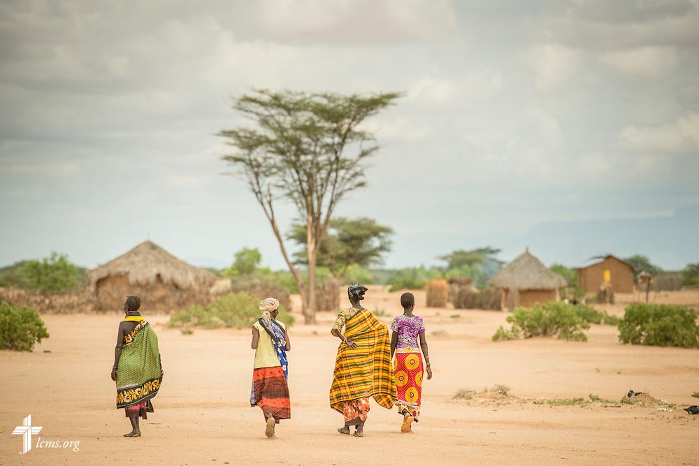 Women walk to their homes on Monday, June 20, 2016, in Turkana, Kenya.  LCMS Communications/Erik M. Lunsford