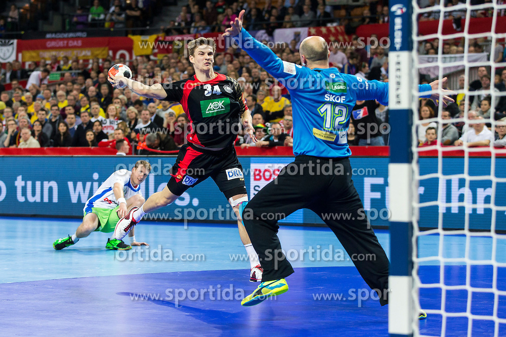 20.01.2016, Jahrhunderthalle, Breslau, POL, EHF Euro 2016, Deutschland vs Slowenien, Gruppe C, im Bild Rune Dahmke (Nr. 34, THW Kiel) im Konter gegen Gorazd Skof (Nr. 12, HBC Nantes) // during the 2016 EHF Euro group C match between Germany and Slovenia at the Jahrhunderthalle in Breslau, Poland on 2016/01/20. EXPA Pictures &copy; 2016, PhotoCredit: EXPA/ Eibner-Pressefoto/ <br /> <br /> *****ATTENTION - OUT of GER*****