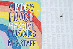 © Licensed to London News Pictures. 13/07/2020. Wakefield, UK. The World's largest greetings card thanking NHS staff has been unveiled. The card measuring over 18 metres long was produced by the Card Factory at their head office in Wakefield. It lists the names of members of the public who gave money , totalling almost £27,000 , to be donated to NHS charities. Photo credit: Scott Merrylees/LNP