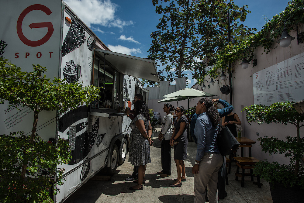 """PORT OF SPAIN, TRINIDAD - FEBRUARY 15, 2017: One of the coolest new additions to Port of Spain's food scene is a stationary food truck called G-Spot, which is parked in its own open air backyard on Maraval Road. Here you'll find what's quite possibly the healthiest and most contemporary food on the whole island: grain bowls made with a blend of brown and red jasmine rice, topped with grilled vegetables, tamarind sauce and mango chutney; crepes stuffed with handmade pork and beef sausage from local artisanal producer Del Mano, and sides of dasheen (taro) mashed with butter, milk and fresh herbs. Try the """"Trinitella"""" for dessert: a sweet crepe filled with a housemade spread made from hazelnuts and Trini chocolate. PHOTO: Meridith Kohut for The New York Times"""