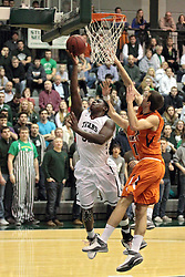 01 March 2014:  Victor Davis lays up a shot during an NCAA mens division 3 CCIW  Championship basketball game between the Wheaton Thunder and the Illinois Wesleyan Titans in Shirk Center, Bloomington IL