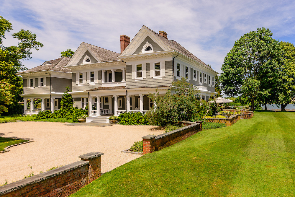 Georgian-style 1900s residence on Mecox Bay. Designed originally by architect, W.E. Brady, Cobb Rd, Water Mill, NY