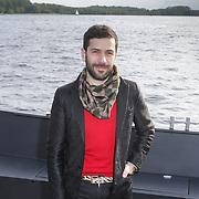 NLD/Amsterdam/20120514 - Presentatie Cointreau fles vol strikjes ontworpen door Alexis Mabille, aankomst Alexis Mobille per boot