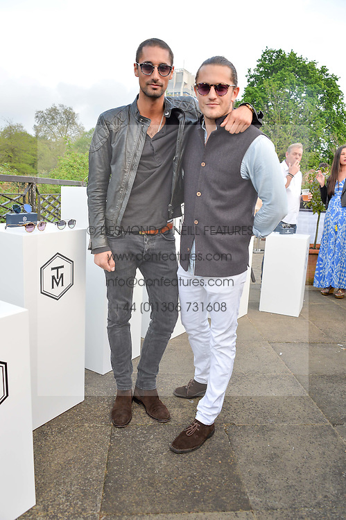 Left to right, HUGO TAYLOR and CHARLIE MORRIS at a party to launch the Taylor Morris Explorer Collection held at the Serpentine Lido, Hyde Park, London on 11th May 2016.