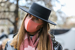 © Licensed to London News Pictures. 14/02/2020. London, UK. A fashion enthusiast wearing fashionable face mask arrives for the London Fashion Week shows in The Strand. The latest Coronavirus patient in London is linked to 'super spreader'attended transport conference with 250 people in Westminster. Photo credit: Dinendra Haria/LNP