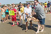 Sea Turtle Rescue volunteers carry Lady, an adult rehabilitated loggerhead sea turtle into the Atlantic Ocean during a release June 30, 2016 in Isle of Palms, South Carolina. The turtle was found severely emaciated and spent a year in rehabilitation at the South Carolina Aquarium sea turtle hospital in Charleston.
