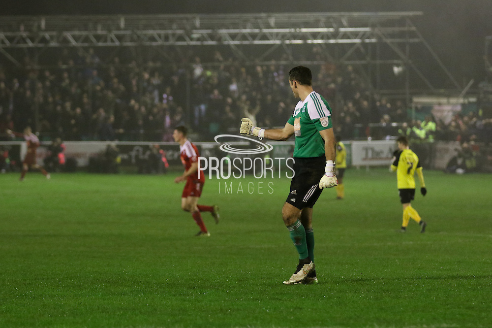 Whitehawk goalkeeper Craig Ross celebrates Whitehawks goal during the The FA Cup 2nd round replay match between Whitehawk FC and Dagenham and Redbridge at The Enclosed Ground, Whitehawk, Brighton, United Kingdom on 16 December 2015. Photo by Ellie Hoad.