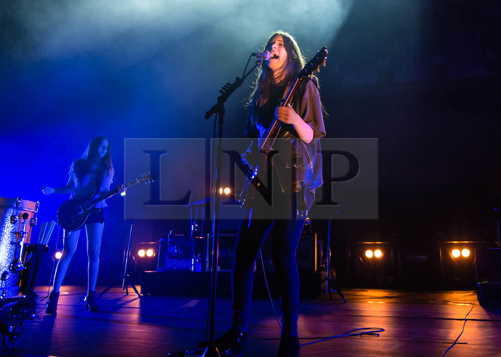 © Licensed to London News Pictures. 06/03/2014. London, UK.   Haim performing live at Brixton Academy for their biggest ever UK headline date a week after winning Best International Band at the NME Awards, having also been nominated in the Best International Group category at the Brit Awards in February, and also having won Best Live Act at the 2014 The Fly awards. In this picture - Este Haim (left), Danielle Haim (right).  Haim is an American rock band consisting of sisters Este Arielle, Danielle and Alana  Haim along with drummer Dash Hutton.   Photo credit : Richard Isaac/LNP