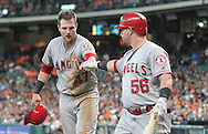 Jun 22, 2016; Houston, TX, USA ; Los Angeles Angels right fielder Kole Calhoun (56) congratulates catcher Jett Bandy (47) for scoring against the Houston Astros in the third inning at Minute Maid Park. Mandatory Credit: Thomas B. Shea-USA TODAY Sports