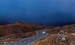 THEMENBILD - ein Auto fährt auf der Strasse. Die Grossglockner Hochalpenstrasse verbindet die beiden Bundeslaender Salzburg und Kaernten mit einer Laenge von 48 Kilometer und ist als Erlebnisstrasse vorrangig von touristischer Bedeutung, aufgenommen am 15. September 2016, Bruck a. d. Glocknerstrasse, Oesterreich // a car traveling on the road. The Grossglockner High Alpine Road connects the two provinces of Salzburg and Carinthia with a length of 48 km and is as an adventure road priority of tourist interest at Bruck a. d. Glocknerstrasse, Austria on 2016/09/15. EXPA Pictures © 2016, PhotoCredit: EXPA/ JFK