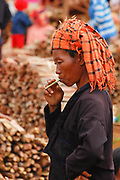 A woman at the market in Indein, Burma (Myanmar) smokes as she contemplates a transaction