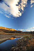 Evening light reflected in still water of Soda Butte Creek, Yellowstone.