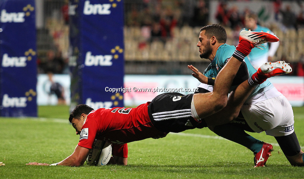 David Havili of the Crusaders runs in a try in the tackle of Shaun Venter of the Cheetahs during the Investec Super Rugby game between the Crusaders v Cheetahs at AMI Stadium in Christchurch. 21 March 2015 Photo: Joseph Johnson/www.photosport.co.nz