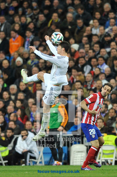 Cristiano Ronaldo of Real Madrid jumps for a head kick during the Copa Del Rey match at the Estadio Santiago Bernabeu, Madrid<br /> Picture by Marcos Calvo Mesa/Focus Images Ltd +34 654142934<br /> 05/02/2014
