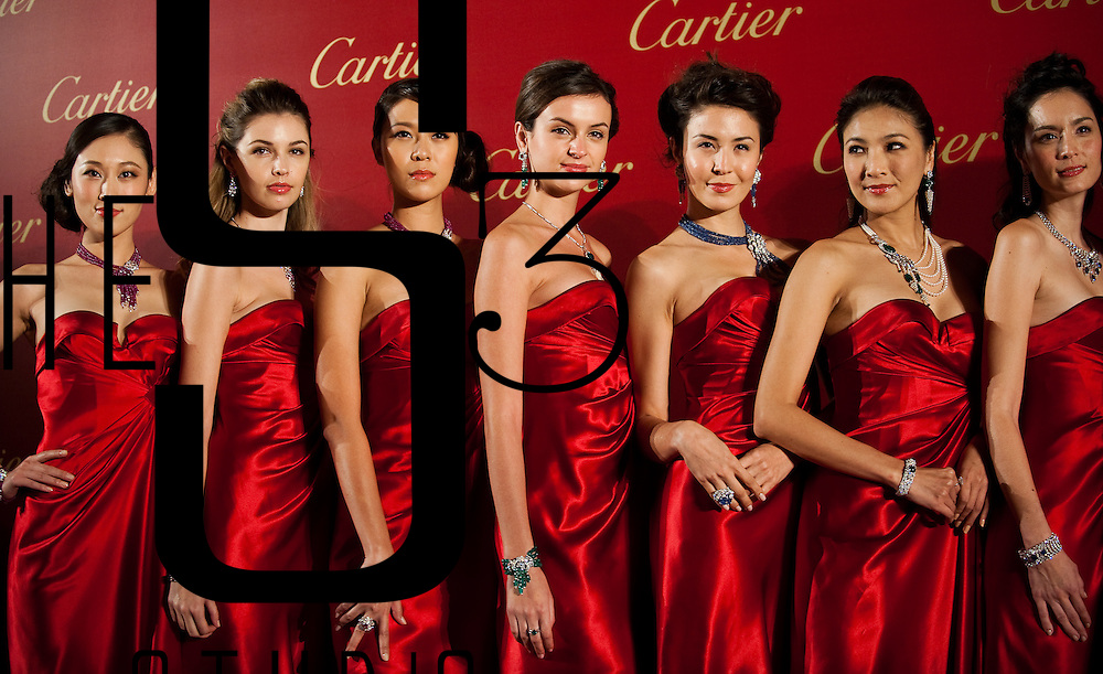 Models pose for the media with Cartier jewelry during the Cartier Flagship Opening Gala Dinner on November 26, 2010 in Hong Kong. Photo by Victor Fraile / Getty Images for Cartier
